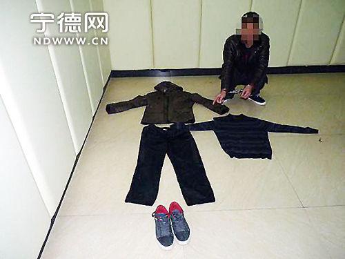 被抓获的嫌疑人。