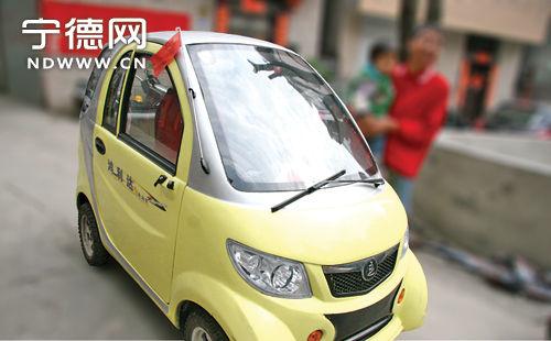 """看见一辆浅黄色迷你""""小汽车""""从身旁轻巧地驶过,这种车宁德目前图片"""