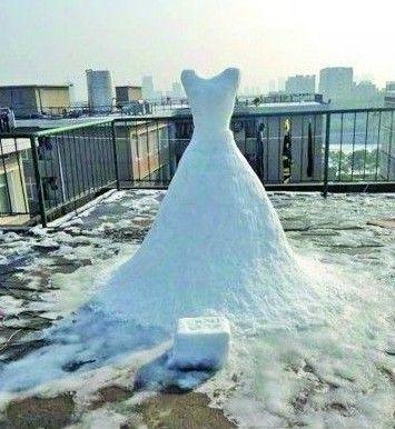 """从小喜欢服装设计   这件""""婚纱""""高约2米"""